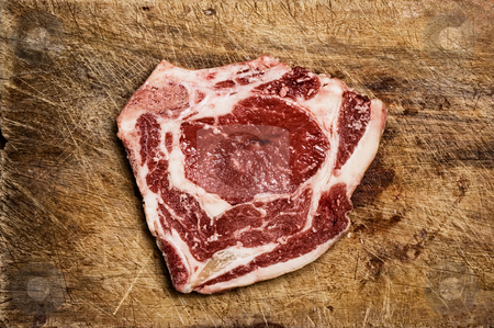 Beef steack on wooden table. stock photo, Beef steack on wooden table. by Pablo Caridad