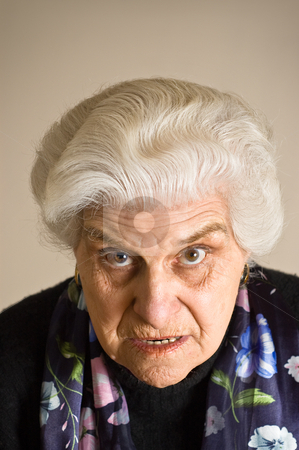 Portrait of an angry mature woman. stock photo, Portrait of an angry mature woman, looking to camera. by Pablo Caridad