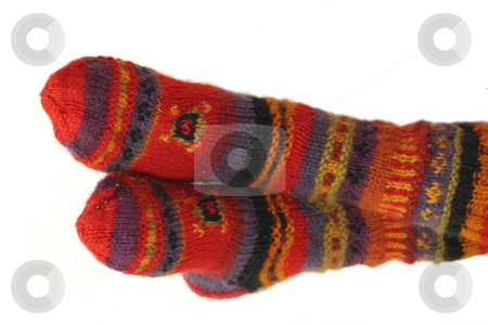 Warm Feet stock photo, Warm feet covered in brightly colored wool socks. by Great Divide Photography