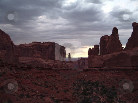 Arches National Park at stormy sunset stock photo, Taken near to the Park entrance as a storm rolled in. by JKJ Anderson