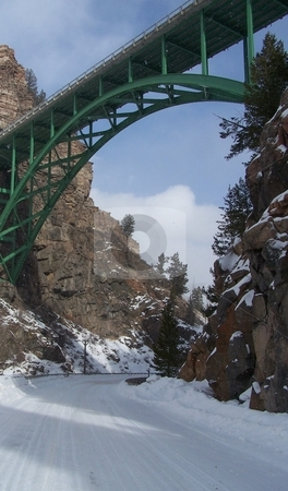 Bridge in the snow stock photo, This green bridge, near to Vail, Colorado, and the 10th Mountain Division huts, spans a narrow canyon and this snowy road. by JKJ Anderson
