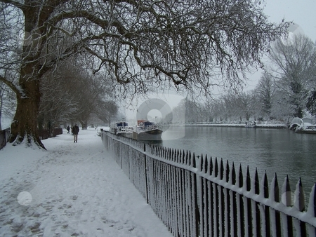 Snowy walk along the River Thames stock photo, Walking along the Thames on a rare snowy day in Oxford. by JKJ Anderson