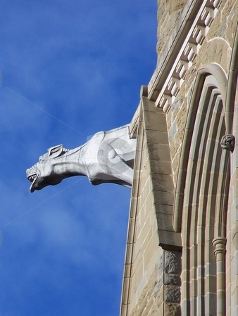 Gargoyle of Bendigo Cathedral stock photo, This gargoyle hung off the side of the cathedral in Bendigo, Australia. by JKJ Anderson