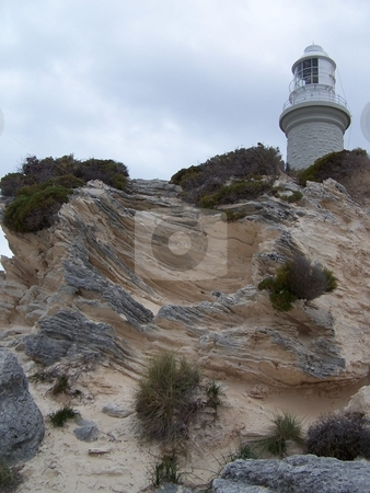 Lighthouse on Rottnest Island stock photo, Taken from a beach on Rottnest Island, looking up towards a lighthouse. by JKJ Anderson