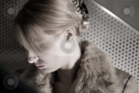 Portrait of a depressed blond girl stock photo, Portrait of a beautiful blond girl looking sad by Frenk and Danielle Kaufmann