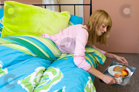 Putting my breakfast aside my bed stock photo, Paris Hilton look-a-like putting her breakfast tray down by Frenk and Danielle Kaufmann