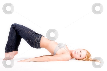Young blond girl in lingerie stretching stock photo, Studio portrait of a young blond girl in bra in a creative pose by Frenk and Danielle Kaufmann