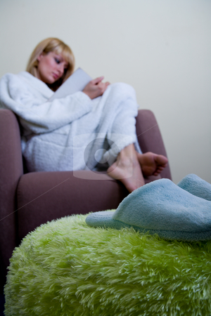 Morning slippers in front of reading woman stock photo, Blond model by Frenk and Danielle Kaufmann