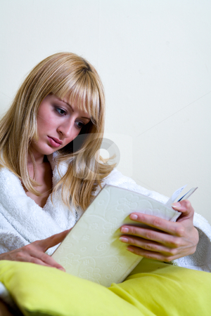 Reading a book stock photo, Blond model is reading a book by Frenk and Danielle Kaufmann