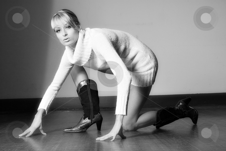 Cowboy boots and a white sweater stock photo, Portrait of a beautiful blond girl dressed in a white sweater and boots by Frenk and Danielle Kaufmann
