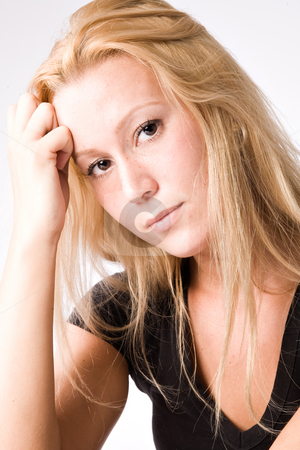 Portrait of a Young blond girl made in the studio stock photo, Studio portrait of a young blond girl looking pensive by Frenk and Danielle Kaufmann