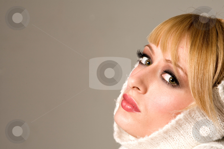 Sweater on my head stock photo, Portrait of a beautiful blond girl with a sweater on her head by Frenk and Danielle Kaufmann