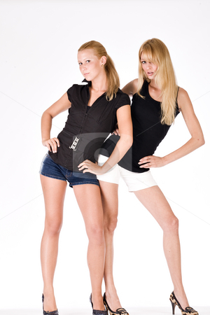 Two sisters posing fashion style stock photo, Two sisters in shorts striking a fashion pose by Frenk and Danielle Kaufmann