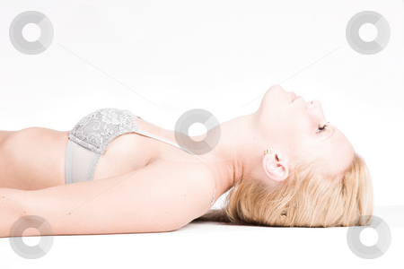 Young blond girl in lingerie stock photo, Studio portrait of a young blond girl in bra only posing by Frenk and Danielle Kaufmann