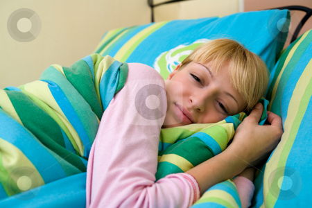 Feeling sleepy stock photo, Blond model waking up in payamas by Frenk and Danielle Kaufmann