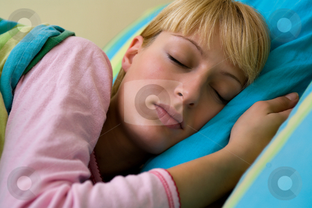 Sleeping stock photo, Blond model sleeping in her pyjamas by Frenk and Danielle Kaufmann