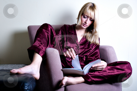 Relaxing reading a book stock photo, Blond model relaxed in a chair reading a book by Frenk and Danielle Kaufmann