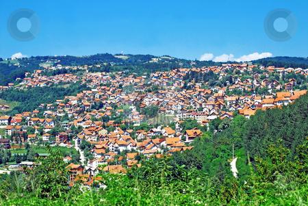 Rural landscape stock photo, Rural landscape of serbian village,green hill and blue sky by Julija Sapic