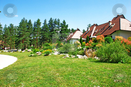 Cottage village stock photo, Weekend mountain houses green grass in Serbia, Zlatibor by Julija Sapic