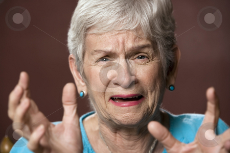 Upset Senior Woman stock photo, Upset senior with a worried expression on her face by Scott Griessel