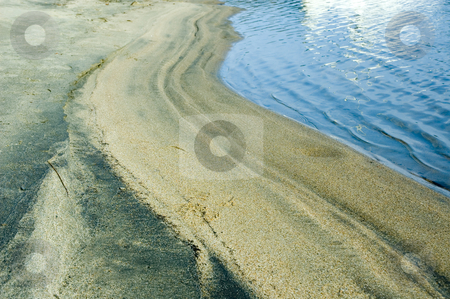 Beach stock photo, Small sand dunes made by the waves of a lake by Vlad Podkhlebnik