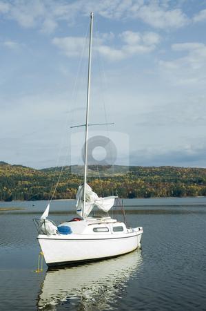 Boat stock photo, A small white sail boat near the shore by Vlad Podkhlebnik