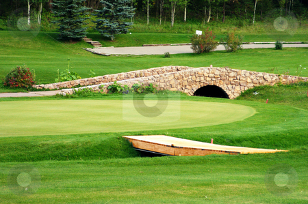 Golf course stock photo, A stone bridge on a green golf course by Sam Sapp