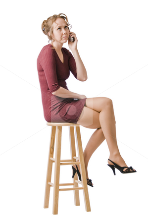 Talking to the ex-husband stock photo, Young woman looks unhappy talking on the phone. by RCarner Photography