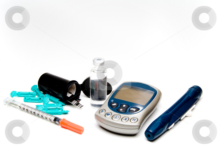 Diabetic Meter  stock photo, A diabetics test meter and finger prick device by Robert Byron