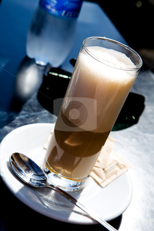 Coffee latte outdoors stock photo, Glass of hot coffee latte outdoors by Vitaly Sokolovskiy