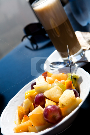 Fruit salad outdoors stock photo, Fruit salad and coffee latte outdoors by Vitaly Sokolovskiy