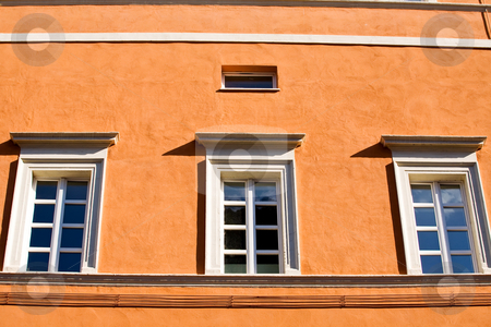 Windows of Rome City stock photo, Windows on orange wall in Rome, Italy by Vitaly Sokolovskiy