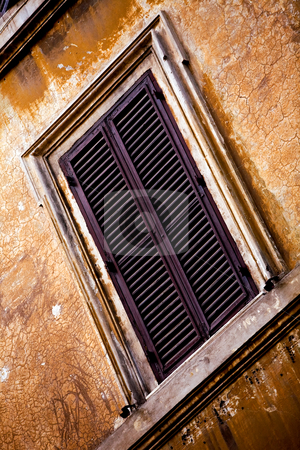 Windows of Rome City stock photo, Window on old orange wall in Rome, Italy by Vitaly Sokolovskiy