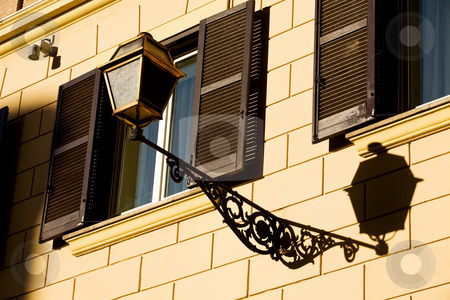 Windows of Rome City stock photo, Windows on yellow wall in Rome, Italy by Vitaly Sokolovskiy
