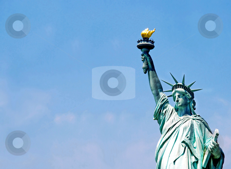 Statue of Liberty stock photo, Statue of Liberty fragment over blue sky by Julija Sapic