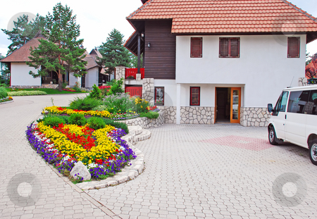 Cottage village stock photo, Weekend houses with gardens and stone road in Serbia, Zlatibor by Julija Sapic