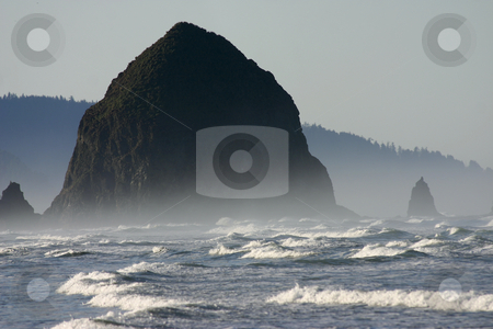 Haystack Rock stock photo, Haystack rock with ocean waves. by Nikki Rose