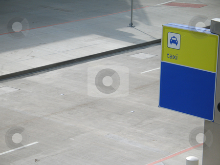 Yellow and blue taxi sign stock photo, Yellow and blue taxi sign by Mbudley Mbudley