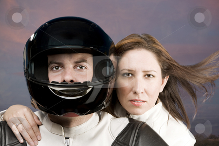 Man and woman on a motorcycle stock photo, Man and woman on a motorcycle in studio by Scott Griessel