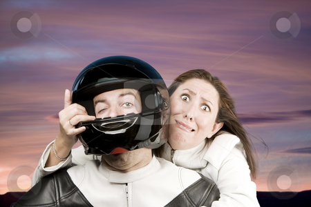 Man and fearful woman on a motorcycle stock photo, Man and fearful woman on a motorcycle in studio by Scott Griessel