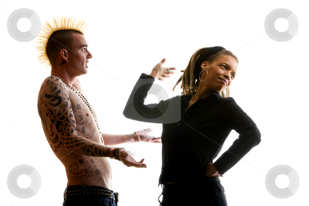 Clueless Man and Reacting Woman stock photo, Man with Mohawk and Woman wearing Dreadlocks by Scott Griessel