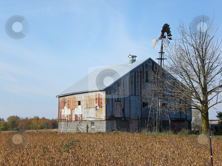 Old barn and windmill stock photo,  by J.G. Byers