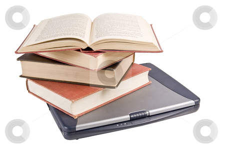 Technology, old and new stock photo, Small stack of books on a laptop by RCarner Photography