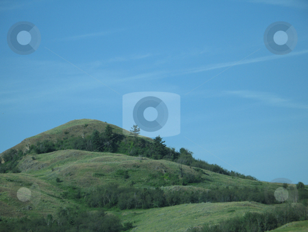 Green hill and blue sky stock photo, Green hill and blue sky by Mbudley Mbudley