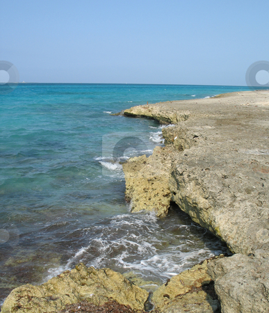 Cliff over the caribbean ocean stock photo, Cliff over the caribbean ocean by Mbudley Mbudley