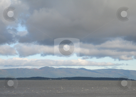 Ocean and mountain landscape stock photo, Ocean and mountain landscape by Mbudley Mbudley