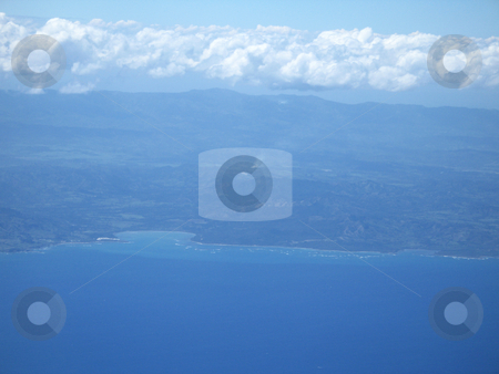 Ocean and land viewed from a plane stock photo, Ocean and land viewed from a plane by Mbudley Mbudley