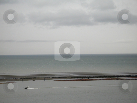Grey ocean with logs stock photo, Grey ocean with logs by Mbudley Mbudley