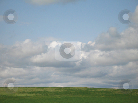 Green valley and cloudy sky stock photo, Green valley and cloudy sky by Mbudley Mbudley