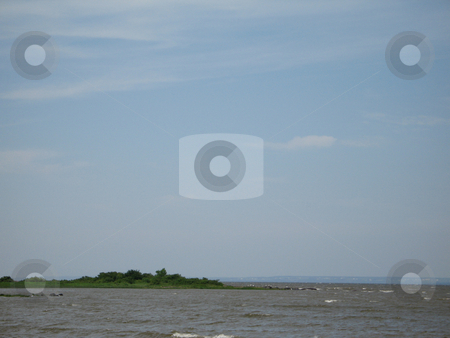 Island in the middle of the river stock photo, Island in the middle of the river by Mbudley Mbudley